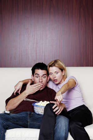 Couple watching movie at home. Stock Photo - 3192533