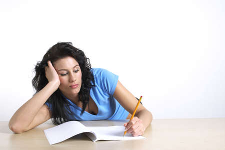 Woman frustrated with her homework. Stock Photo - 3192540