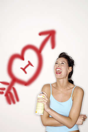 Woman laughing while holding a colour spray. Stock Photo - 3192543