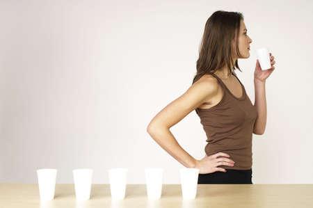replenishing: Woman drinking water.