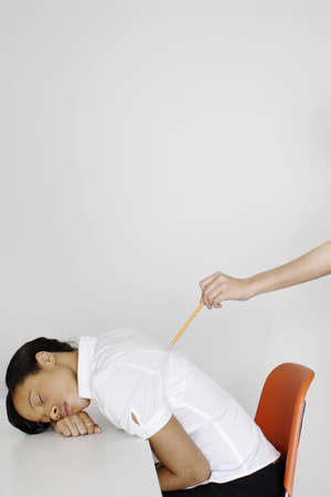 Hand poking woman's back with a pencil. Stock Photo - 3192549