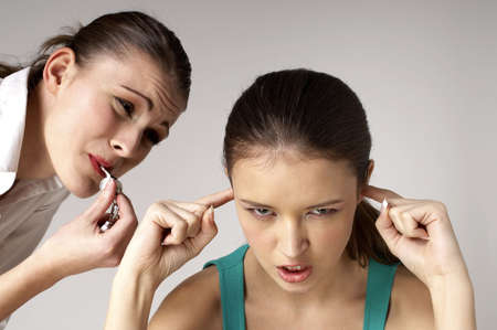 Annoyed girl closing her ears from the whistle's noise. Stock Photo - 3192554