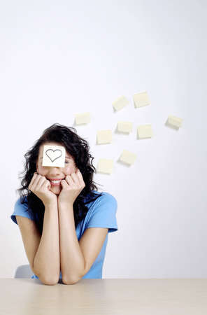 Woman with a paper sticking on her forehead. Stock Photo - 3192567
