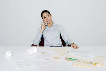 laziness: Businesswoman talking on the mobile phone. LANG_EVOIMAGES