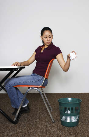 Woman throwing crumpled paper into the dustbin. Stock Photo - 3192581
