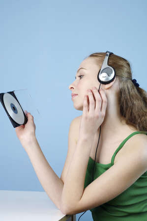 Woman listening to music on the headphones. Stock Photo - 3192597