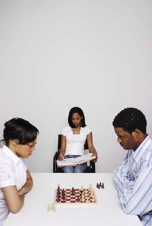 Man and woman competing in a chess competition. Stock Photo - 3192599