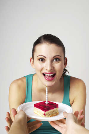 Woman surprised to get a birthday cake. Stock Photo - 3192615