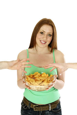 Woman holding a bowl of potato chips. LANG_EVOIMAGES