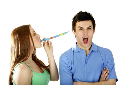 Woman blowing blowout at man. Stock Photo - 3192622