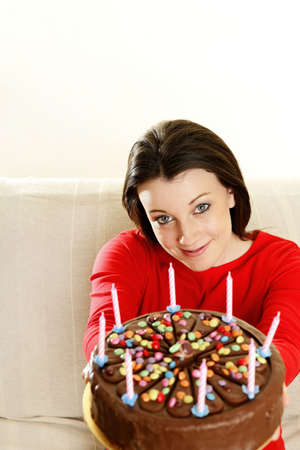 Woman holding a birthday cake. Stock Photo - 3192623