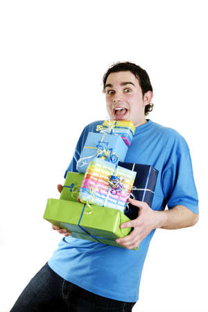 Man carrying a stack of presents. Stock Photo - 3192625
