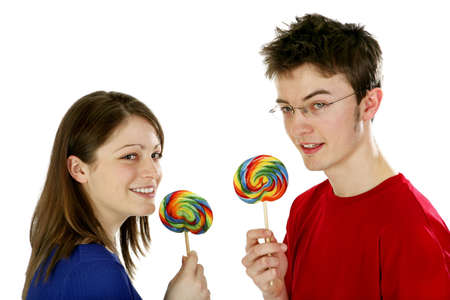 Man and woman holding candy.