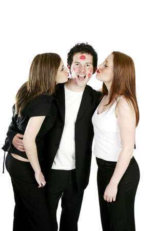 Two women kissing a man. LANG_EVOIMAGES