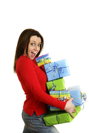 Woman carrying a stack of presents.