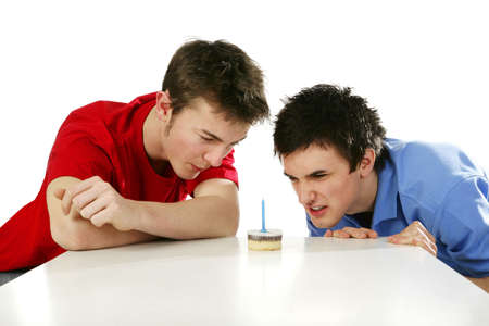 Men looking at a small birthday cake. Stock Photo - 3192645