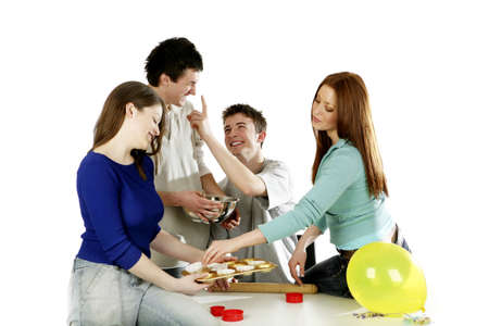Men and women having fun baking cake together. Stock Photo - 3192651