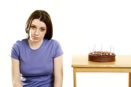 Woman sitting beside her birthday cake. Stock Photo - 3192653
