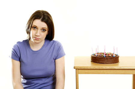 Woman sitting beside her birthday cake. Stock Photo - 3192653