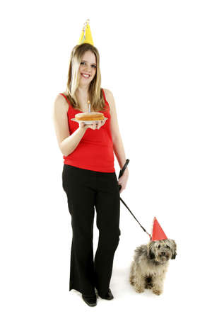 Woman celebrating birthday with her dog.