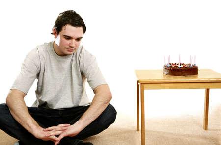 Man sitting beside his birthday cake. Stock Photo - 3192655