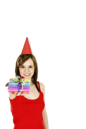 Woman with party hat holding a present. LANG_EVOIMAGES