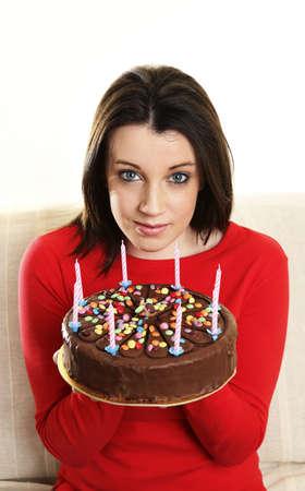 Woman holding a birthday cake. Stock Photo - 3192660