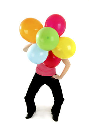 Woman holding colourful balloons. LANG_EVOIMAGES