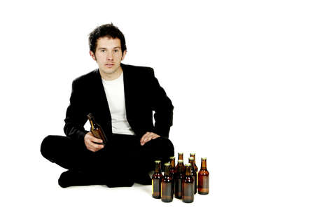 Man sitting with beer bottles.