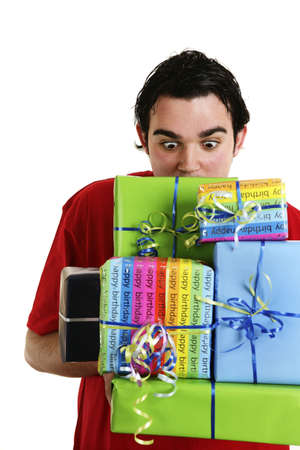 Man carrying a stack of presents. Stock Photo - 3192667