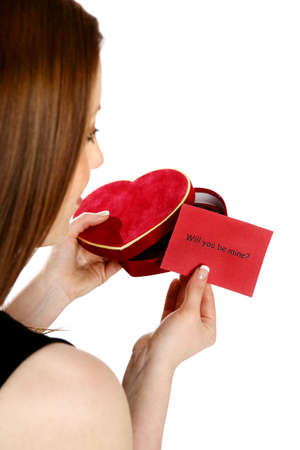 Woman receiving a  proposal gift.