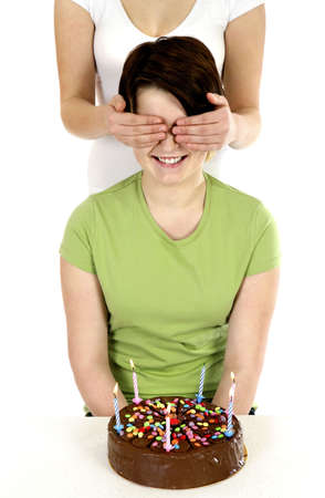 Woman getting a surprise birthday cake. Stock Photo - 3192678