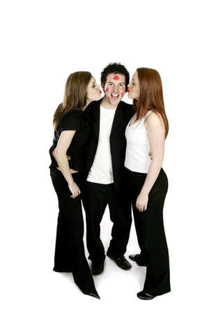lucky man: Two women kissing a man. LANG_EVOIMAGES