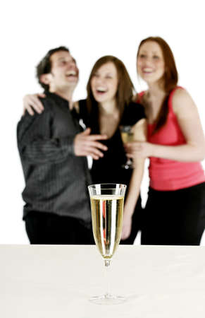Man and women having fun in a party.