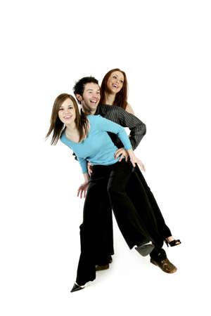 El hombre y dos mujeres bailando.  Foto de archivo - 3192689