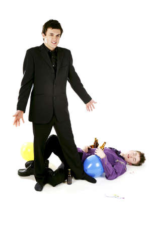 Man standing beside his drunk friend. Stock Photo - 3192693