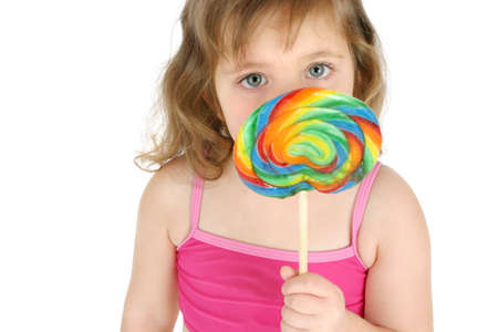 eating: Girl eating lollipop LANG_EVOIMAGES
