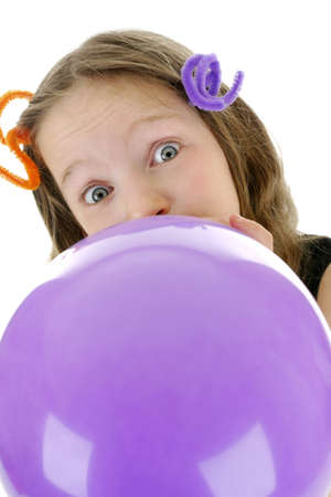 Girl blowing up a purple balloon Stock Photo - 3192935