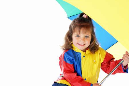 Girl in rain coat holding an umbrella Stock Photo - 3192952