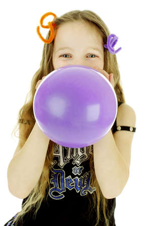 Girl blowing up a purple balloon Stock Photo - 3192955