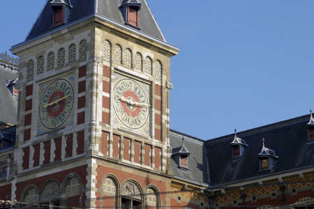 the netherlands: Central Station, Damrak, Amsterdam, Netherlands.