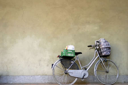objects: Bicycle parking beside a wall. LANG_EVOIMAGES