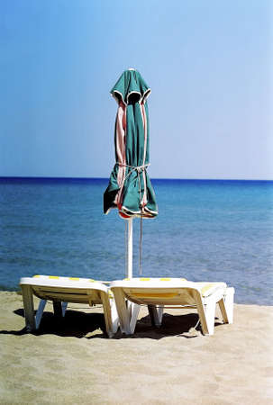 Beach chairs and umbrella. Stock Photo - 3190996