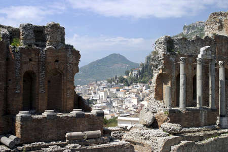 Ruins of old Greek theatre rebuilt in Roman times, Taormina, Sicily, Italy. Stock Photo - 3191058