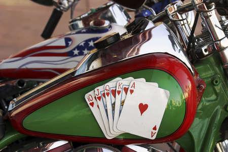 Royal flush on a motorcycle.