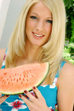 Woman holding a water-melon. Stock Photo - 3191145
