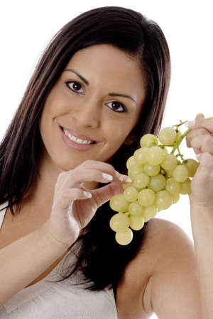 Woman holding green grapes. LANG_EVOIMAGES