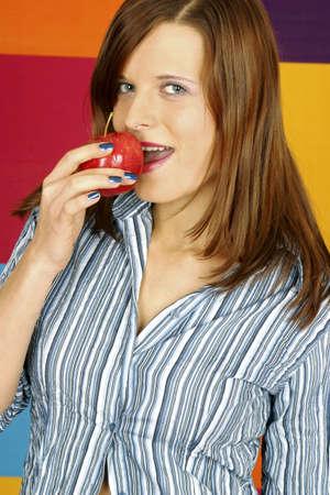 Woman biting an apple. Stock Photo - 3191152