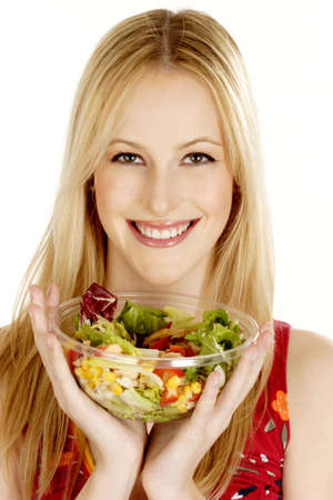 Woman holding a bowl of salad.