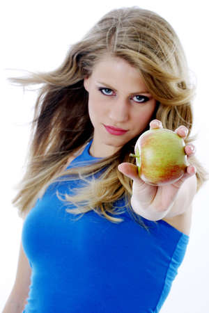 Woman showing an apple. Stock Photo - 3191165